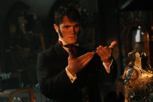 """ONCE UPON A TIME - """"Strange Case"""" - The Evil Queen and Hyde continue on their quest to steal Dr. Jekyll's serum; Snow looks forward to her first day back as a school teacher; and while Emma looks forward to Hook moving in with her, Hook finds himself trying to protect Belle from Mr. Gold, who has made sure she can't leave the confines of the pirate ship. Meanwhile, back in the past, Rumplestiltskin helps Dr. Jekyll complete his serum to separate a man's personality into two - good and evil - but his help comes with a hefty price, on """"Once Upon a Time,"""" SUNDAY, OCTOBER 16 (8:00-9:00 p.m. EDT), on the ABC Television Network. (ABC/Jack Rowand) SAM WITWER"""